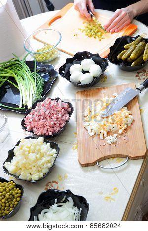 Preparing russian traditional salad Olivier