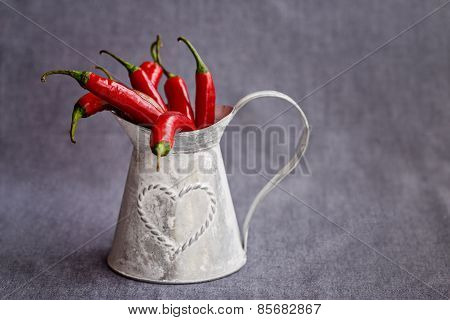 Hot Red Chilli Pepper In A Metal Gray Basket