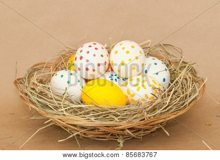 many colored easter eggs in basket