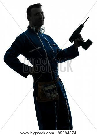 one man construction worker holding drill silhouette in studio on white background