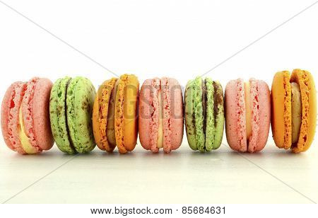 Colorful Macaroons on White Wood Table