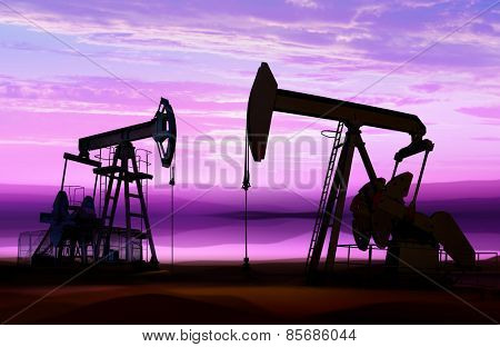 silhouette of working oil pumps on cloud sky