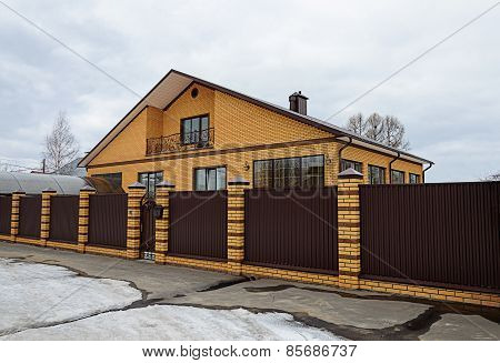 Modern Yellow Brick House With Balcony