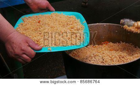 Hot rice pilaf in a pot