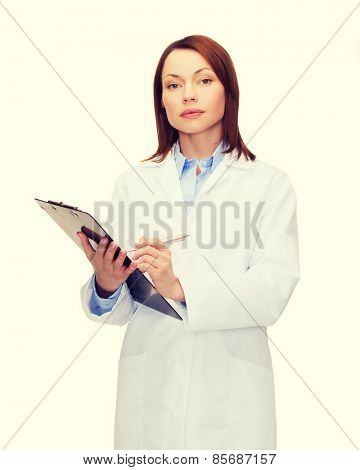 healthcare and medicine concept - calm female doctor with clipboard