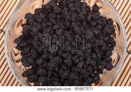 Dried blueberries in a glass bowl - aerial view