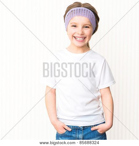 Cute smiling little girl in white t-shirt