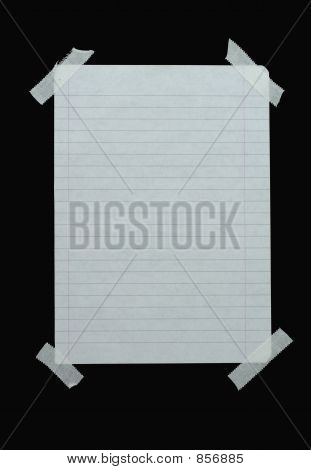 piece of lined paper stuck with tape