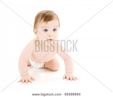 bright picture of crawling curious baby over white backgroubd