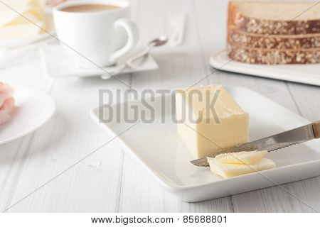 Stick Of Butter On White Plate