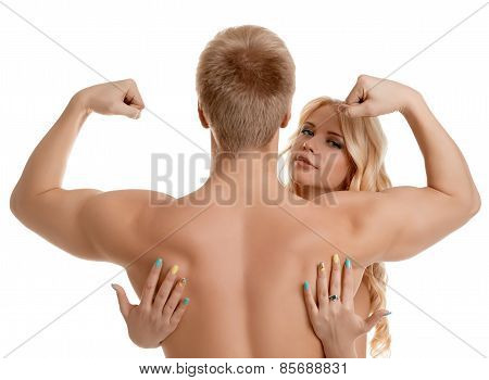 Strong man shows biceps and sexy girl hugs him