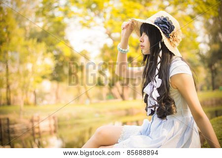 A Cute Asian Thai Girl Is Looking In The Sky With Hope In Natural Atmosphere