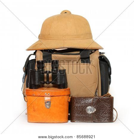 Retro travel baggage with tropical hat and binocular.