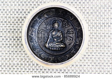 A Tibetan Singing Bowl Depicting Engraving Design Of Buddha Holding A Bowl In Hand