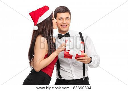 Delighted woman getting a Christmas present from boyfriend isolated on white background