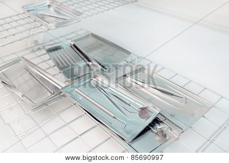 Metal dental medical equipment tools on tray