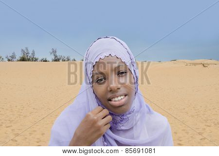 Young Afro beauty wearing an embroidered veil