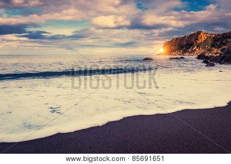 Fantastic view of beach Torre Conca (cape Rais Gerbi). Dramatic scene. Dark overcast sky. Location Cefalu. Tyrrhenian sea. Sicilia, Italy, Europe. Beauty world. Retro style filter. Instagram effect.