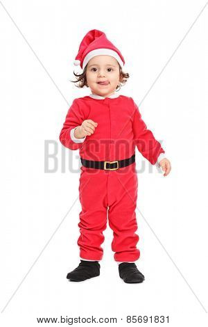 Full length portrait of an adorable little girl in Christmas costume isolated on white background