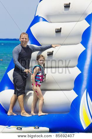 Family Playing on an Inflatable toy at the beach