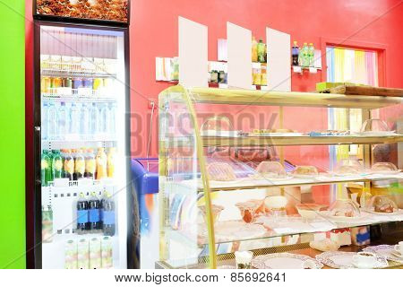 Commercial refrigerator to store drinks and tasty desserts in cafeteria
