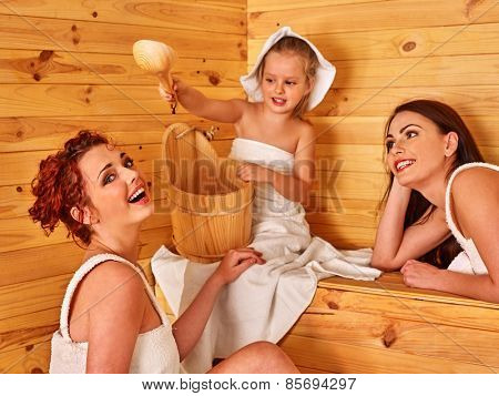 Group people with child in sauna. Healthy lifestyle.