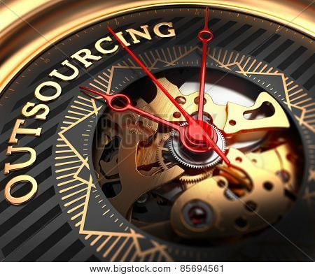 Outsourcing on Black-Golden Watch Face.