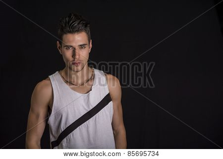 Handsome Black Haired Young Man Isolated On Black