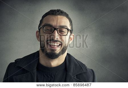 Happy man smiling on a grey background