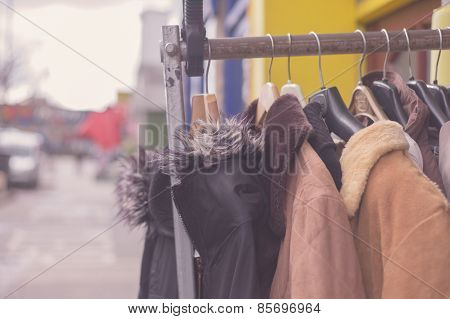Winter Jackets Hanging On Rail Outside