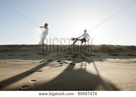 Happy couple flirting at the beach having fun
