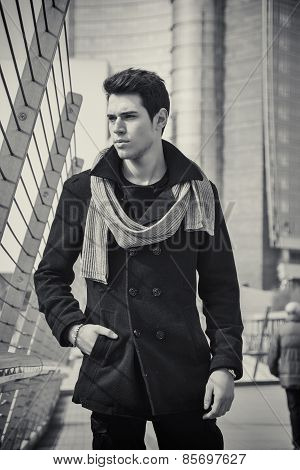Stylish Young Handsome Man In Black Coat Standing In City Center Street
