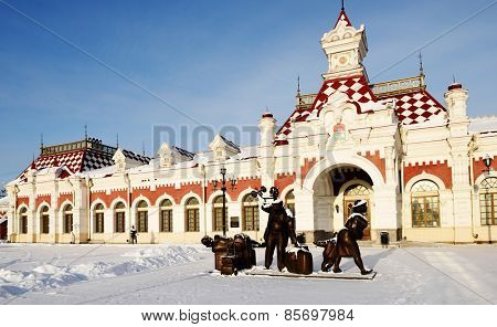 YEKATERINBURG, RUSSIA - JANUARY 1, 2015: Sculpture of passengers in front of the Museum of Sverdlovsk railway. The museum located in the building of first railroad station of Yekaterinburg