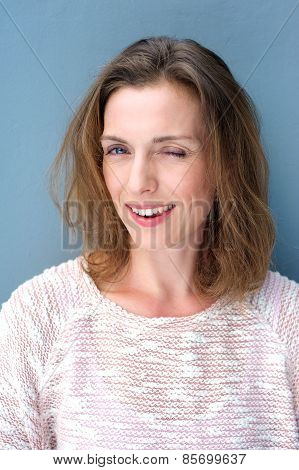 Attractive Older Woman Winking And Flirting