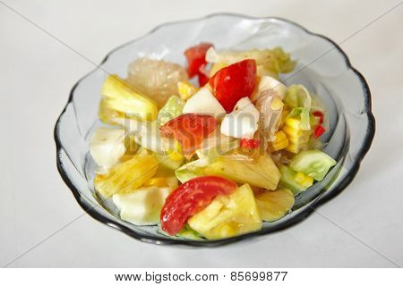 Salad full of fresh fruit and vegetables