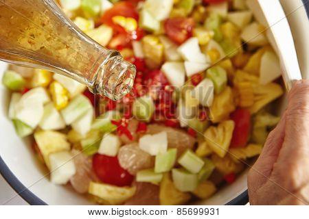 Adding sauce to salad