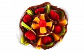 pic of crown green bowls  - exotic fruits in chocolate cream on white bowl - JPG