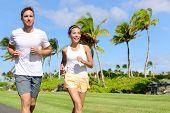 stock photo of cardio  - People running in city park - JPG