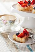 stock photo of custard  - Tartlet with custard and berries and coffee - JPG