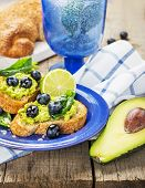 picture of avocado  - Toasts with blueberry and avocado cream - JPG