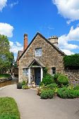 image of slaughter  - Pretty stone cottage alongside the River Eye with the old mill to the rear in the centre of the village Lower Slaughter Cotswolds Gloucestershire England UK Western Europe - JPG