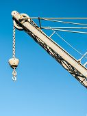 picture of crane hook  - A disused small crane with a hook in the harbor of Genoa (north of Italy) ** Note: Visible grain at 100%, best at smaller sizes - JPG