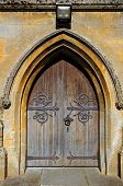 stock photo of church-of-england  - St Davids church doorway Moreton - JPG