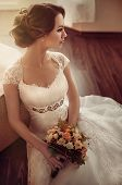 image of marriage ceremony  - Beautiful bride with stylish make-up in white dress ** Note: Soft Focus at 100%, best at smaller sizes - JPG