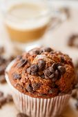 picture of chocolate muffin  - Chocolate a muffin near the coffee latte - JPG