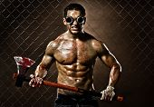 stock photo of rabies  - crazy frenzied chopper butcher man covered with blood action with big axe - JPG