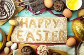 picture of hot-chocolate  - Easter kitchen with baking ingredients including hot chocolate eggs and flour - JPG