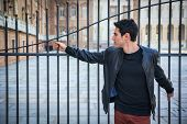 image of turin  - Handsome young man outside historical building in European city  - JPG