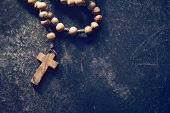 stock photo of beads  - rosary beads on old black background - JPG