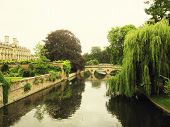 stock photo of academia  - Bridges over river Cam with hanging willow and garden and colleges of the University of Cambridge - JPG